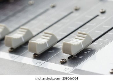 Old buttons equipment in audio Mixing Console