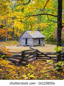 Old cabin framed by colorful fall foliage on Roaring Fork Road, Smoky Mountains National Park