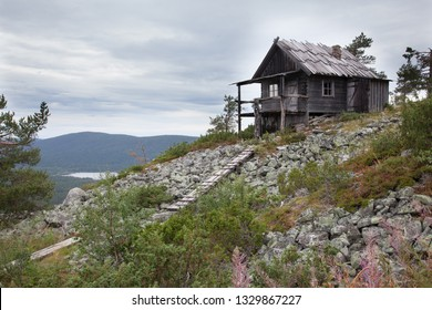 Old cabin on the top of Levitunturi fell on autumn. This cottage is made of wood and it imitates the old way of building