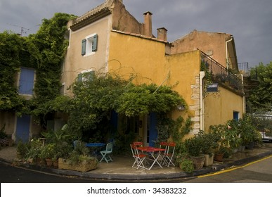 Old cafe and inn on the medieval square of a village in Provence