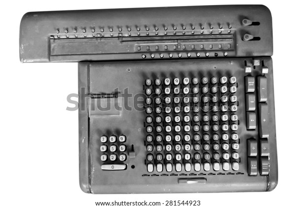 Old calculating machine isolated on white