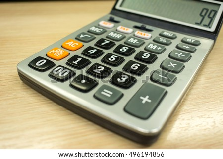 old calculator on table closeup stock photo edit now 496194856