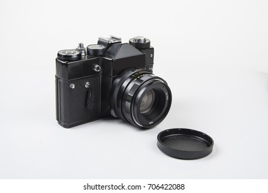 Old camera for the film on white background