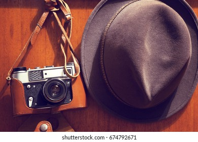 Old camera and hat.Retro style.