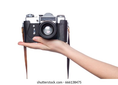 old camera on woman hand over white background