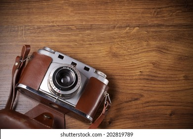 old camera on wood table