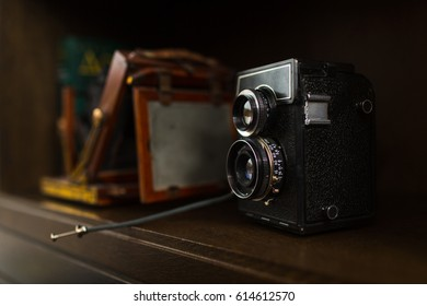 Old camera on wooden cupboard