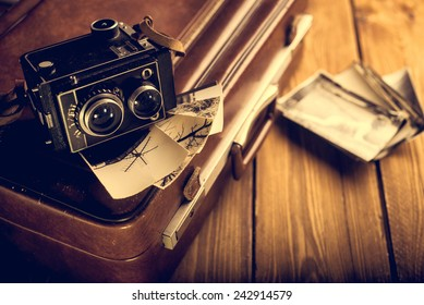Old camera and old photos are on the case. Retouching in retro style