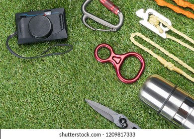 old camera and things for expedition on green grass