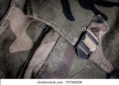 Old camouflage army bag background