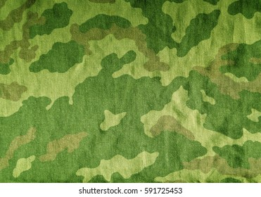 Old camouflage uniform cloth pattern. Abstract background and texture for design.