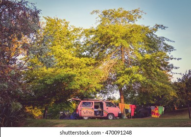 Old camper van at camping site in New Zealand