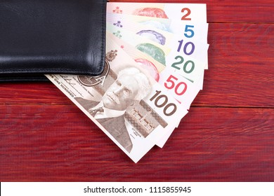 Old Canadian money in the black wallet