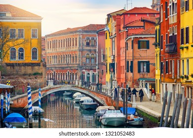 Old canal with boats and bridge in Venice, Italy. Street with old Italian architecture of Venice. Cityscape of beautiful Venice.