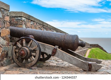 Old cannon behind the fortress wall in Colonia del Sacramento, Uruguay