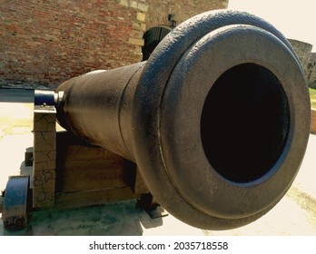 An old cannon to defend the fortress.The barrel of an old cannon.