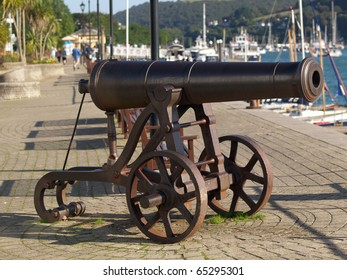 Old cannon in harbor