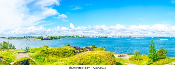 An old cannon on the Island Fortress of Suomenlinna with Helsinki on background, Finland