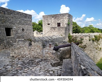 Old cannon on the wall of the fort of San Felipe in Bacalar Lagoon, Mexico
