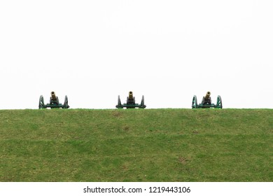 Old cannons, built in a redoubt on a hill. Old cannons stand on high ground, at a strategic height. Three old cannons stand on a hill against a white sky.
