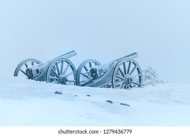 Old cannons. - Shipka, Gabrovo, Bulgaria. The Shipka Memorial is situated on the peak of Shipka in the Balkan Mountains near Gabrovo, Bulgaria. Winter fog, lots of snow, old cannons covered with snow