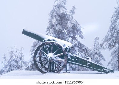 Old cannons. - Shipka, Gabrovo, Bulgaria. The Shipka Memorial is situated on the peak of Shipka in the Balkan Mountains near Gabrovo, Bulgaria. Winter fog, lots of snow, old cannons covered with snow.