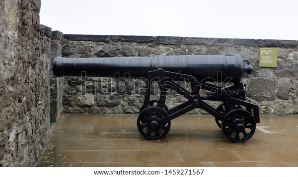 Old canon in the rain.