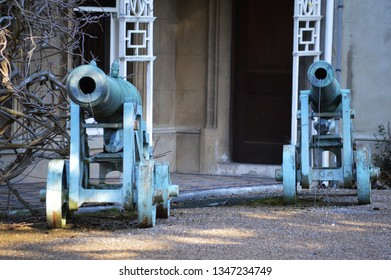 old canons outside house