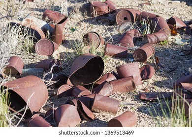 old cans rusting in the desert where they were thrown years ago