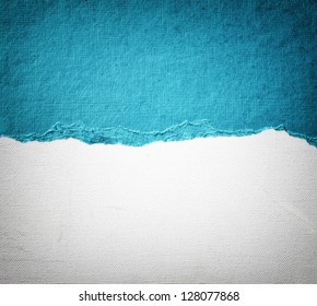 old canvas texture background with delicate stripes pattern and blue vintage torn paper