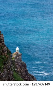Old Cape Point Lighthouse against blue ocean water. Cape of Good Hope, South Africa.