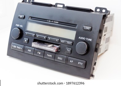 Old car audio CD and cassette player 2 DIN. On a lite background