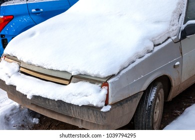 old car covered with snow