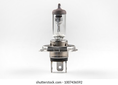 Old car lamp on white background, selective focus with shallow depth of field.