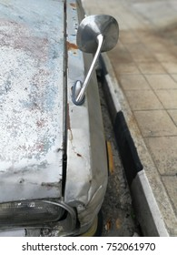 The old car was parked and completely covered by the look of the old and deteriorated condition, it should last a very long time.