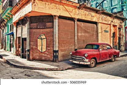 old car parked on the street of habana