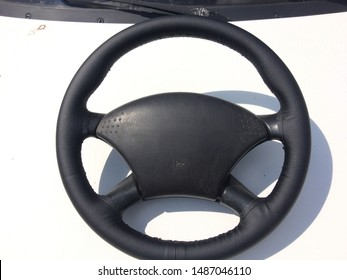 Old car parts. Leather steering wheel.