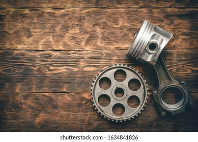 Old car spare parts on wooden workbench background with copy space. Machinery abstract background.