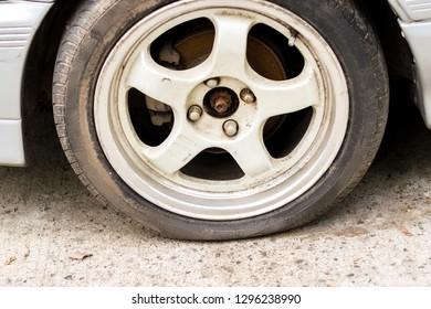 Old car wheel flat tire