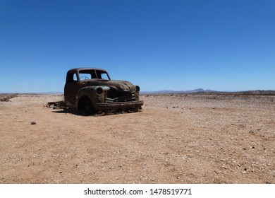 Old car wreck in the desert