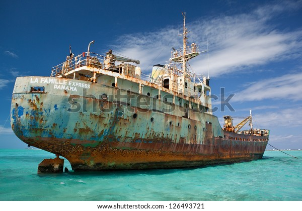 An old cargo ship has run aground in the shallow near the Turks & Caicos Islands.  This shipwreck will eventually turn into a shallow artificial reef.