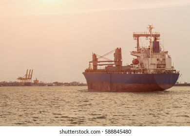 Old cargo ship with sky in evening. (flare tone)