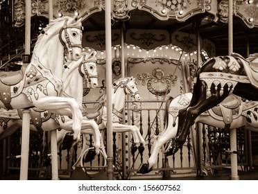 Old carousel horses. Paris. Sepia. Retro style postcard.