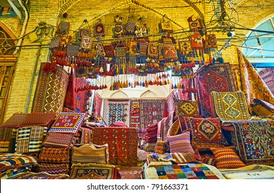 Old carpet stall with kil for each taste - knotted-pile Persian carpets, woven nomadic tribal rugs, handmade or machine made, woolen or cotton, everything can be found in Vakil Bazaar, Shiraz, Iran.