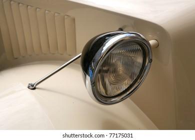 An old car's headlight.
