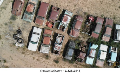 Old cars wreckage gathered in a park, aerial view.