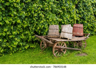 an old cart with barrels
