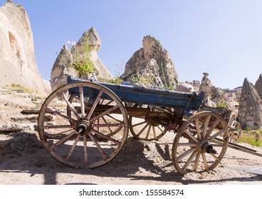 Old cart with unique rock formations in background, Cappadocia, Turkey