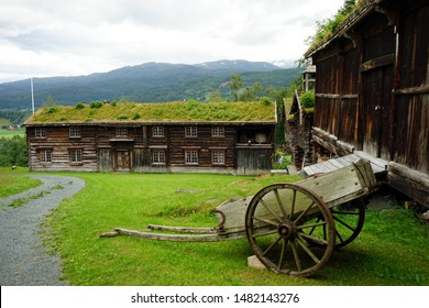 Old cart and wooden barns in farm in Norway