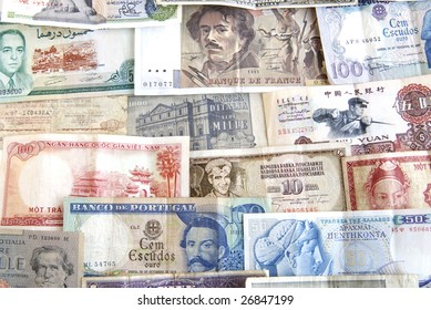 Old cash money from different countries around the world.